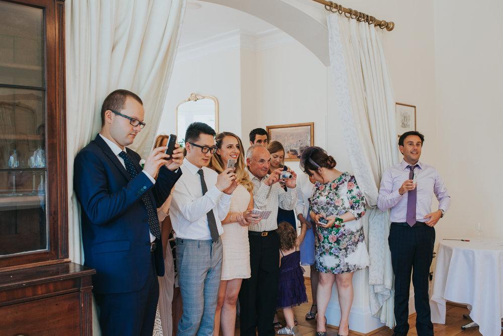 363-blush wedding cake cutting Richmond photographer.jpg
