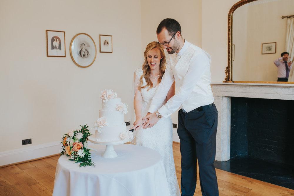 364-blush wedding cake cutting Richmond photographer.jpg