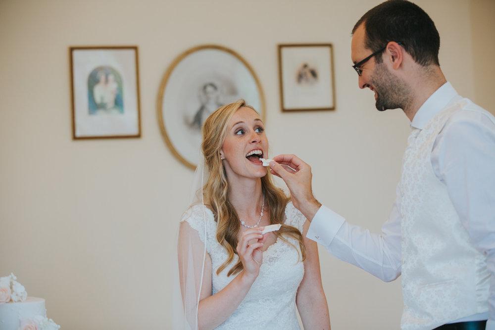 368-blush wedding cake cutting Richmond photographer.jpg