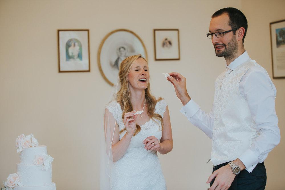367-blush wedding cake cutting Richmond photographer.jpg