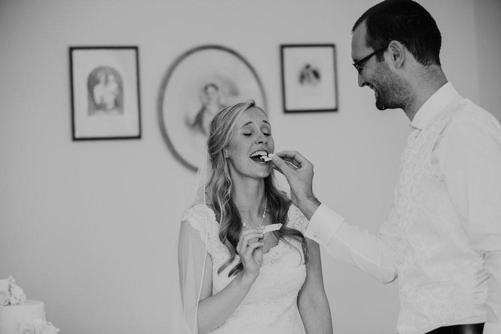 369-blush wedding cake cutting Richmond photographer.jpg