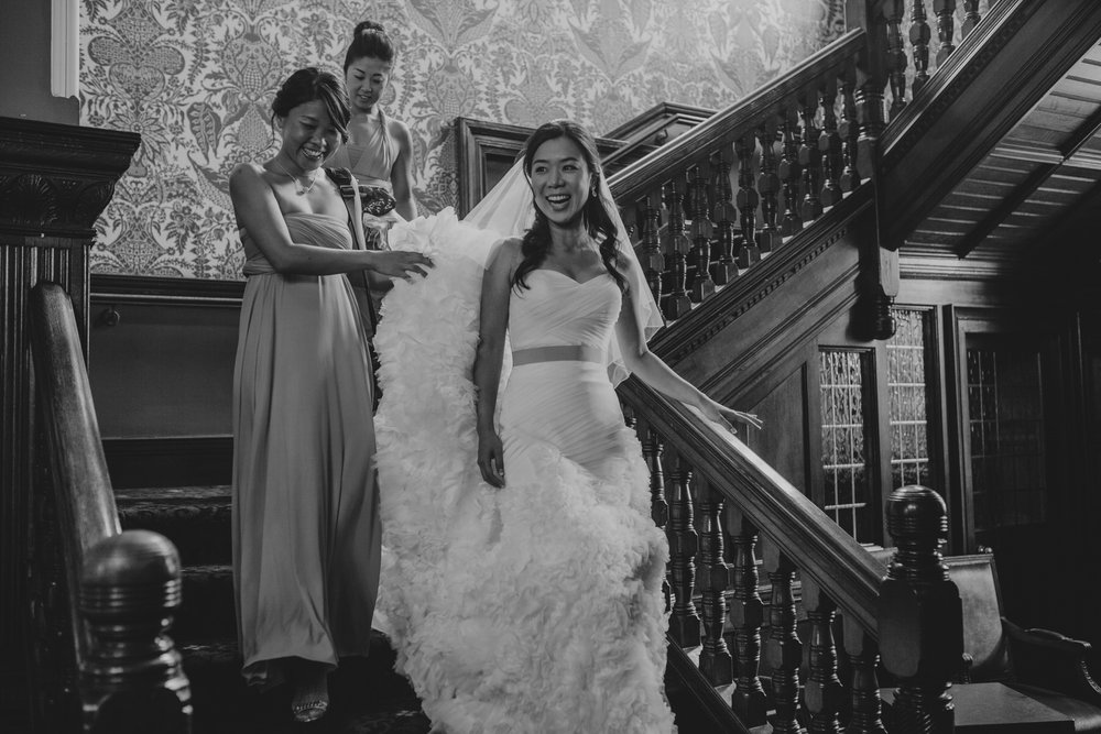 128 bride descends Woodlands Hotel documentary photographer.jpg