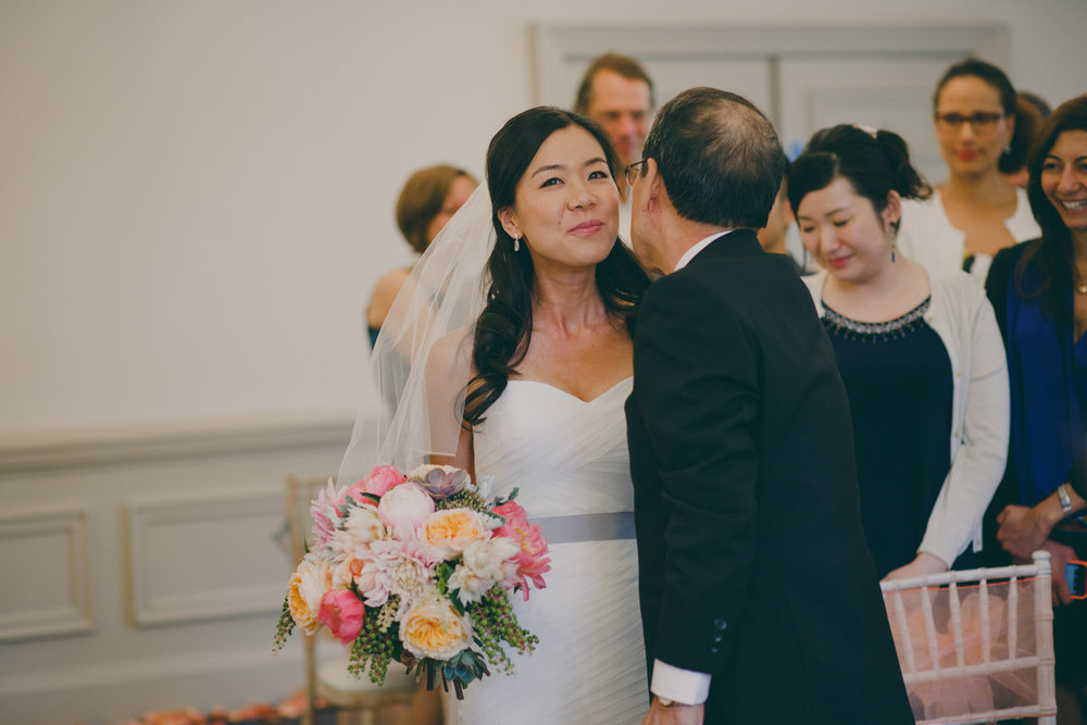 167 father kisses bride Surrey documentary wedding photographer.jpg