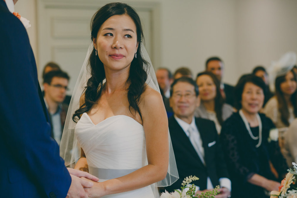 195 brides parents look on at bride wedding ceremony.jpg