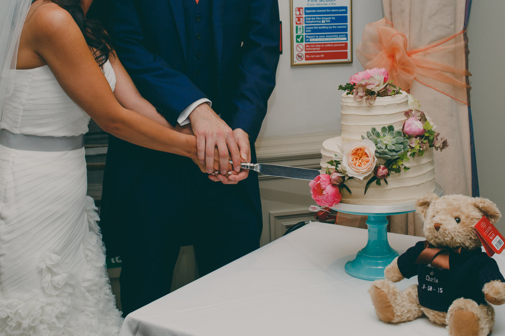 584 cake cutting wedding.jpg