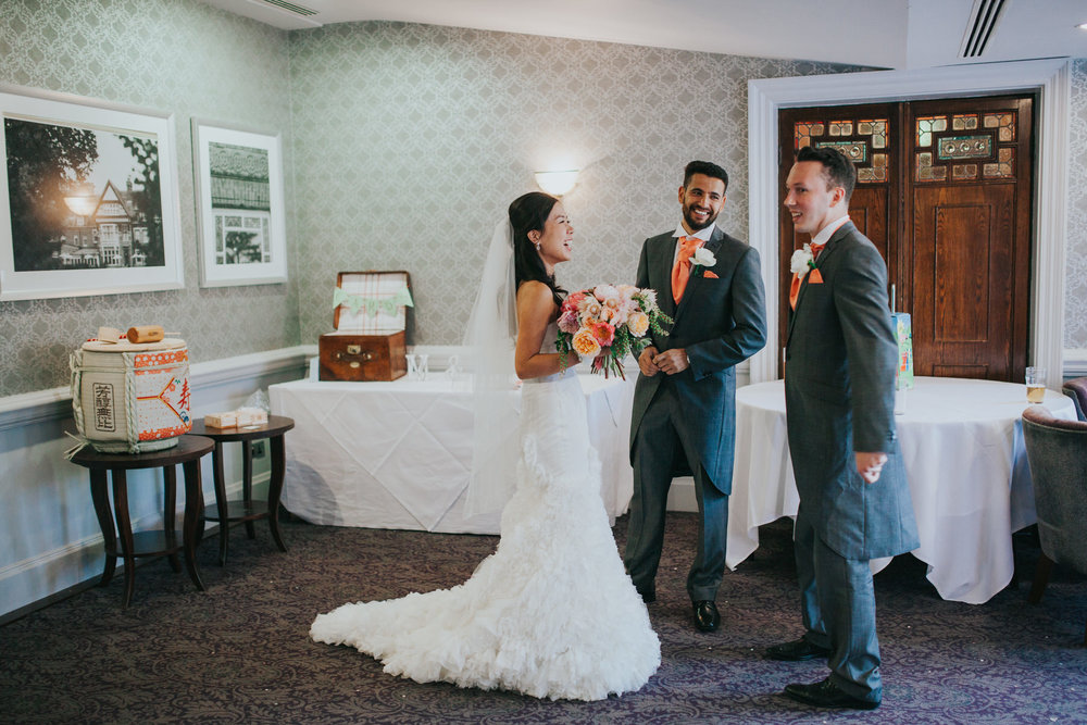 385 bride hanging with ushers Surrey wedding.jpg