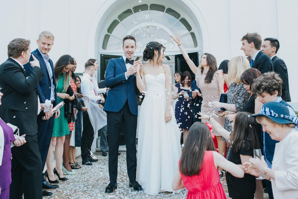 396 Belair House Dulwich wedding groom shows ring.jpg