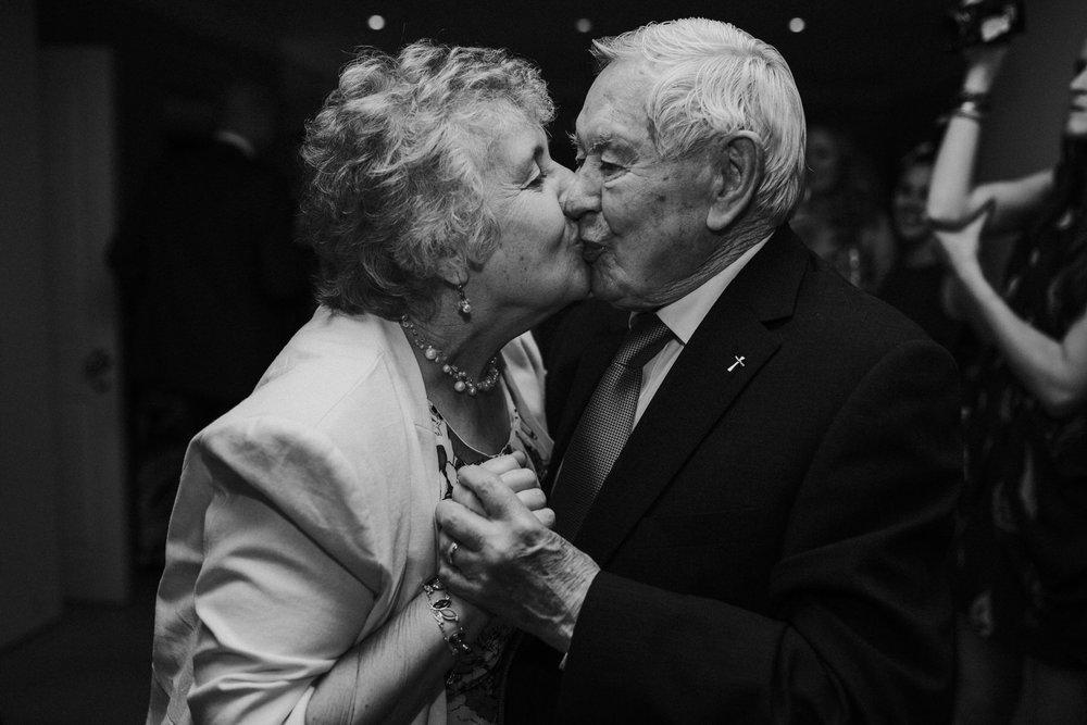 Grandma kissing grandpa dancefloor Bingham Hotel wedding photographer.jpg