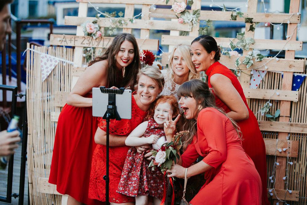 Holborn Studio wedding bridesmaids red dresses selfie time.jpg