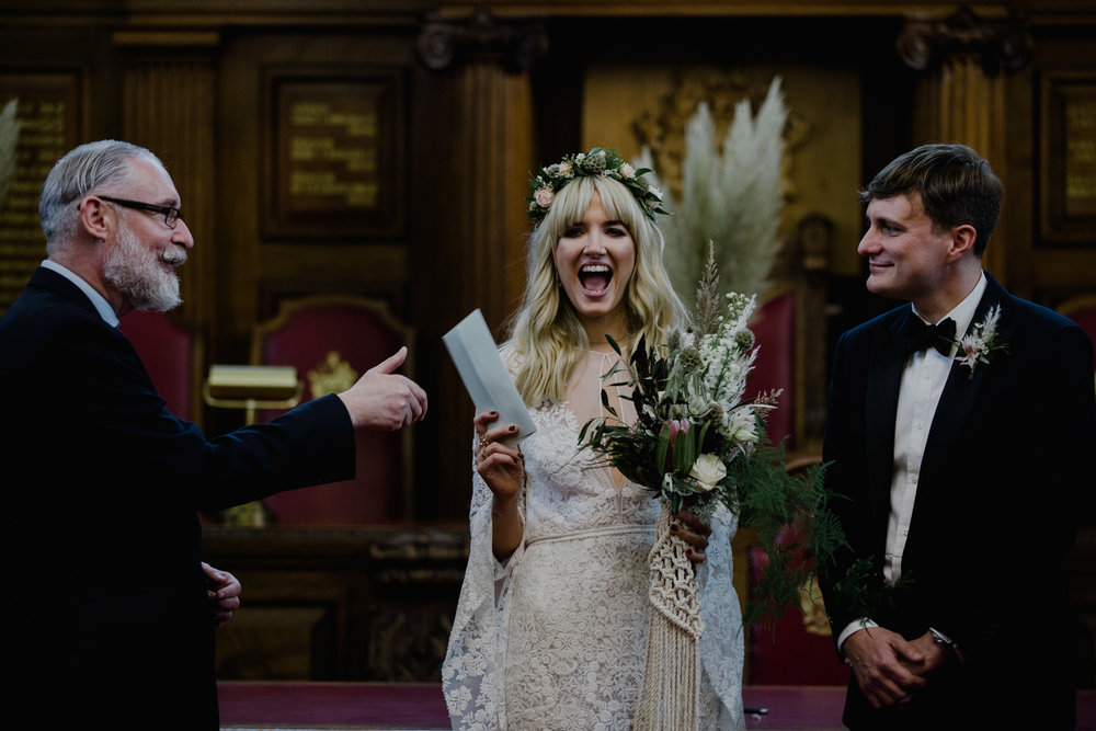 bride receiving marriage certificate London wedding photographer.jpg