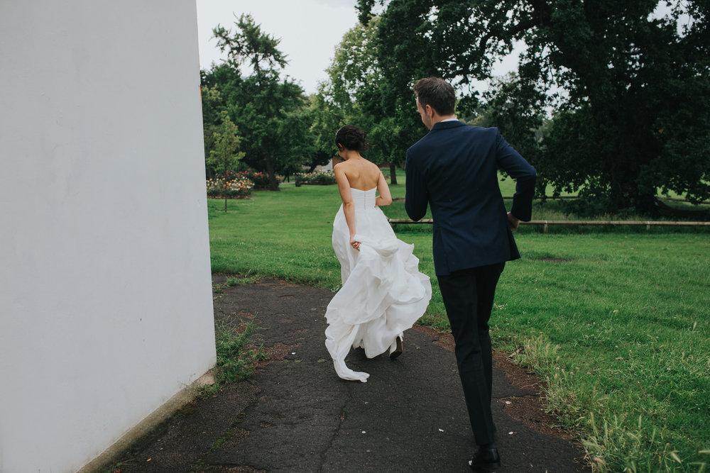466 Belair House bride groom running away rain.jpg