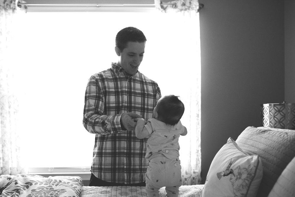 karra lynn lifestyle newborn photographer - dad in front of window