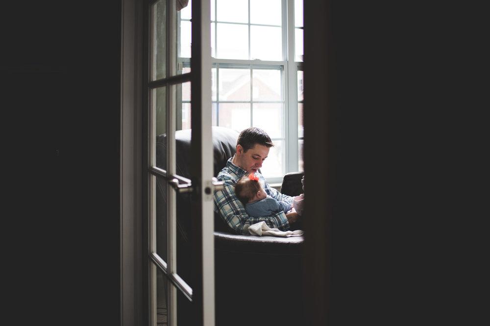 karra lynn lifestyle newborn photographer - dad with baby through door