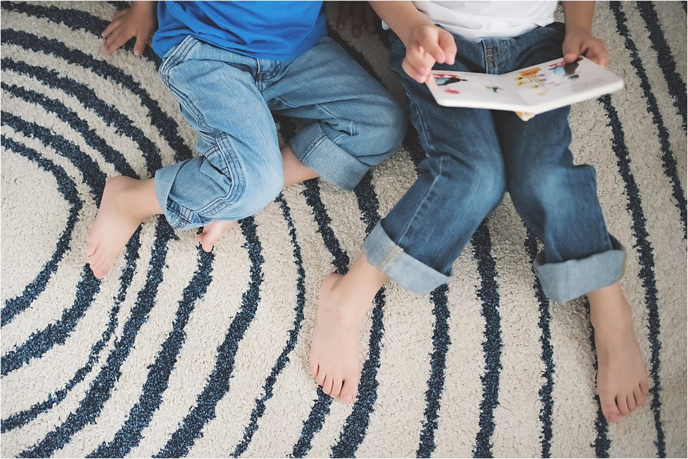 karra lynn photography - family lifestyle photographer michigan - brothers reading feet