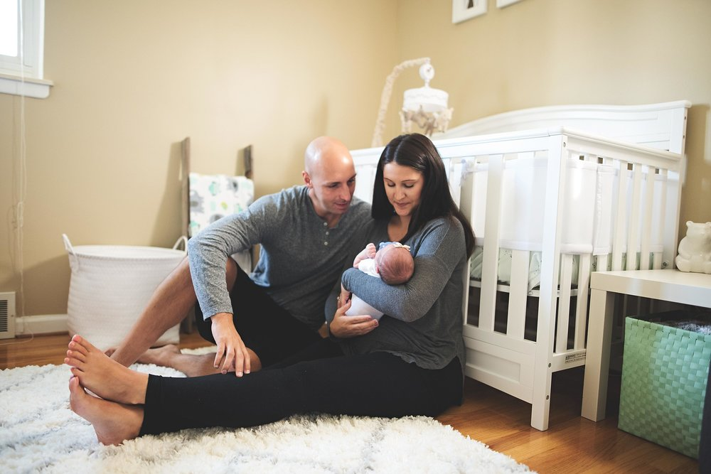 karra lynn photography - at home newborn lifestyle - michigan - parents in nursery