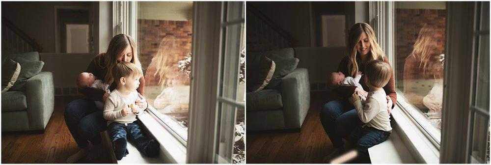 karra lynn photography - newborn photographer northville mi - mom by window