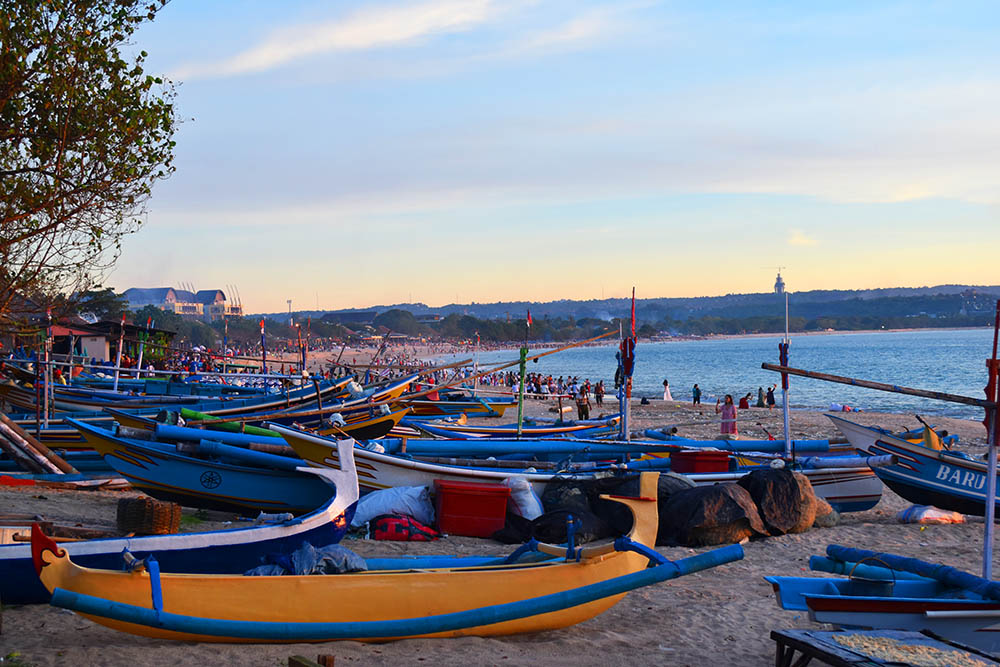 We spent one afternoon here on Jimbaran beach, and were lucky enough to catch this sun set with all these colorful fishing boats lined up along the shore.