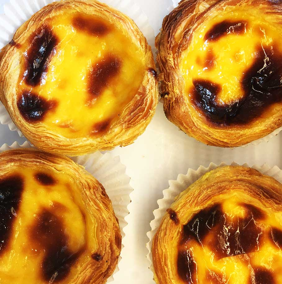 Mouth-wateringly delicious Portuguese custard tarts, known locally as Pastéis de Nata.
