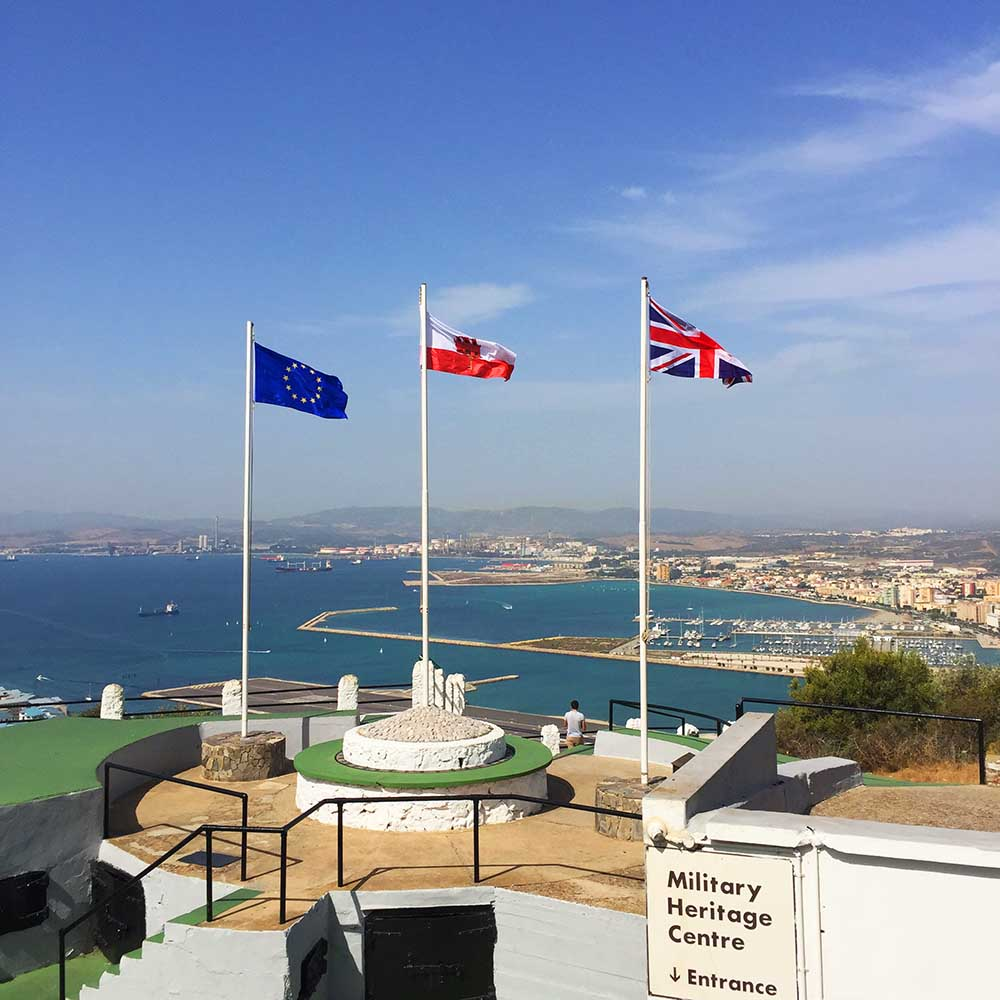 3 flags fly on the rock. From left to right: European Union, Gibraltar, and Britain. Gibraltar did not get the result it wanted from the recent EU referendum. Britain voted to leave the EU, while a vast majority of Gibraltarians voted to remain. Uncertain times lie ahead.