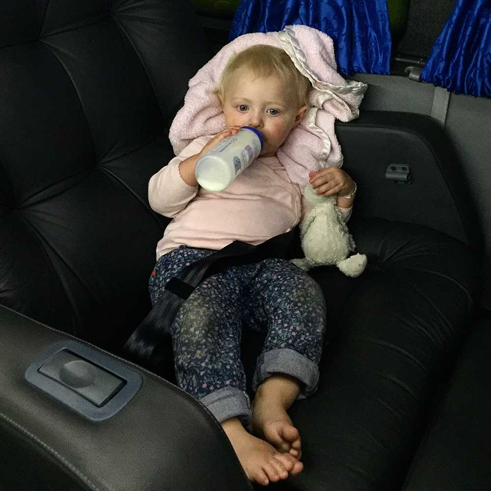 Rosie settling in for our overnight bus ride, over the Andes mountains, from Mendoza, Argentina to Santiago, Chile. Planes, trains, boats, buses... nothing seems to faze her!