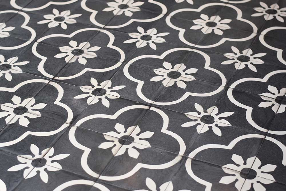 Black and white patterned cement tiles at Ulekan restaurant in Canggu, Bali.