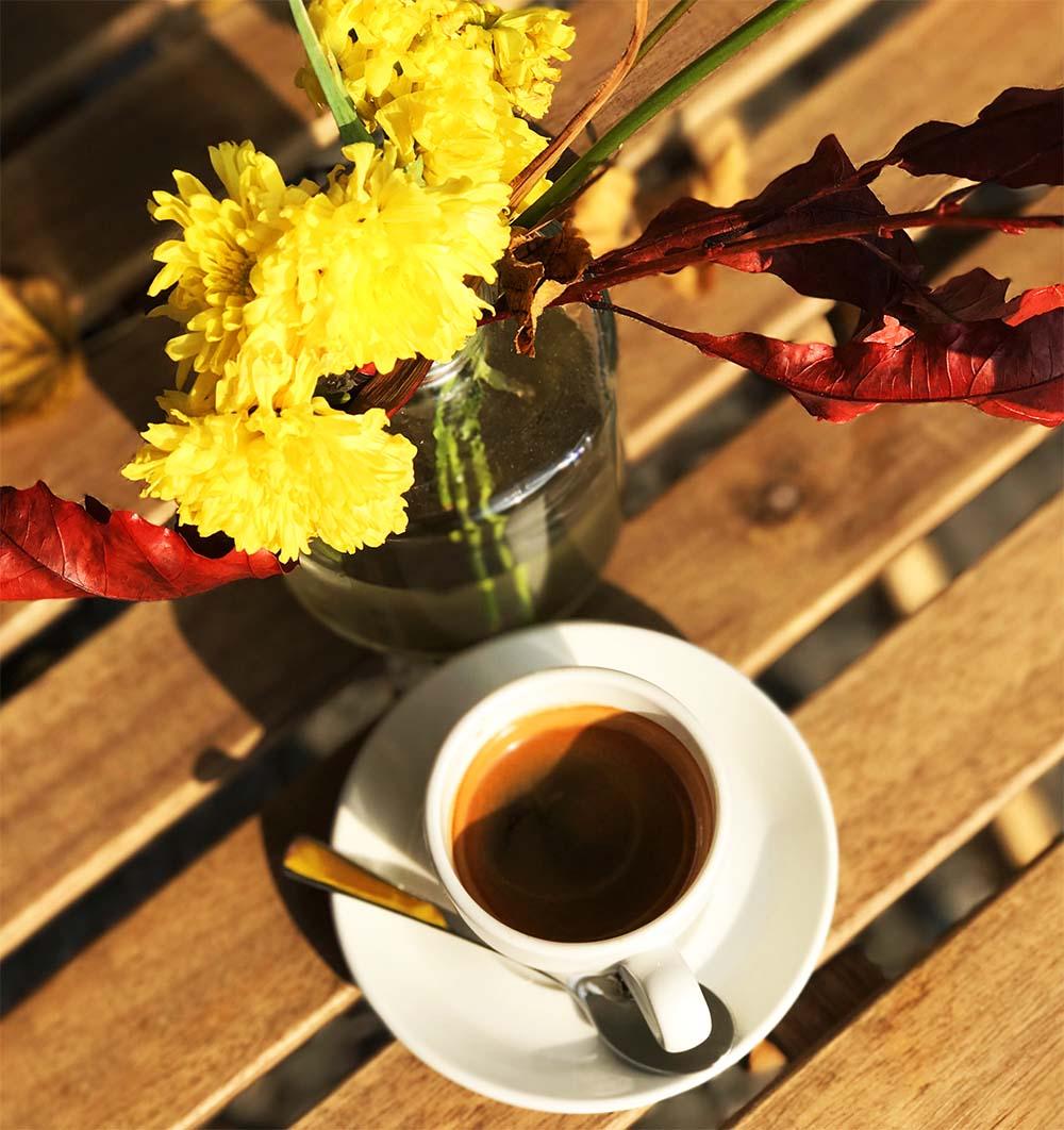 Enjoying an espresso in a coffee shop along the Landwehr Canal in Kreuzberg, Berlin.