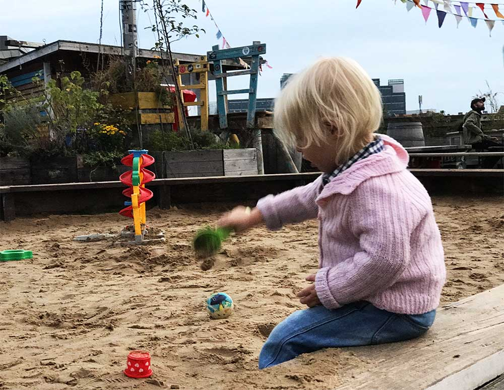 Klunkerkranich. A colorful rooftop bar with live DJ and a sandpit for kids!