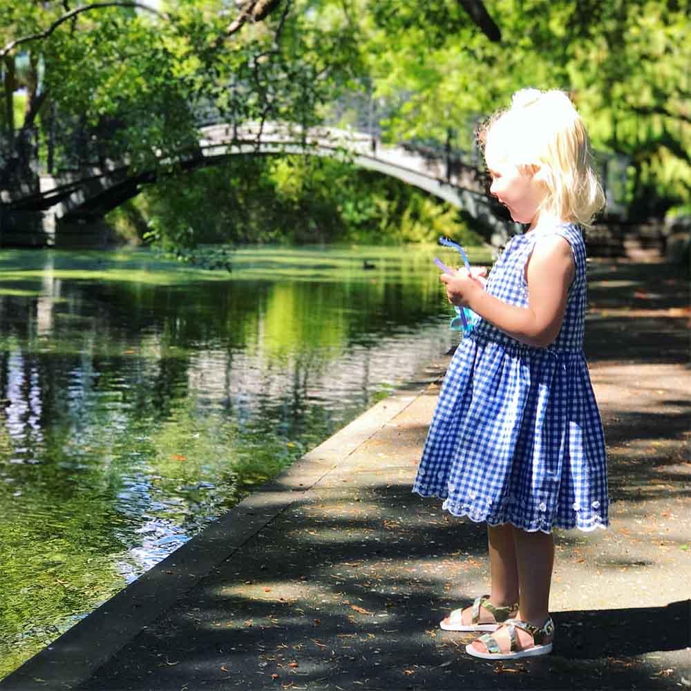 Rosie admiring the ducks in Queen's Garden.