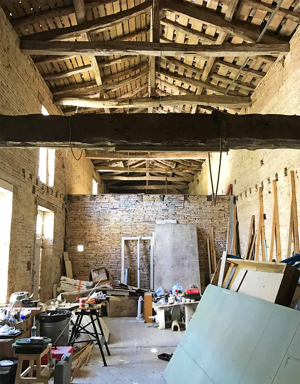 Converting this ancient barn into bedrooms is a big part of the remodel.