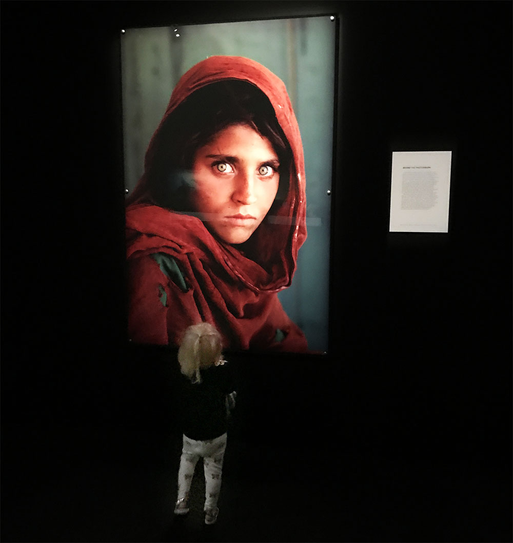 Rosie admiring one of the world's most famous photographs, 'Afgan Girl' by Steve McCurry.