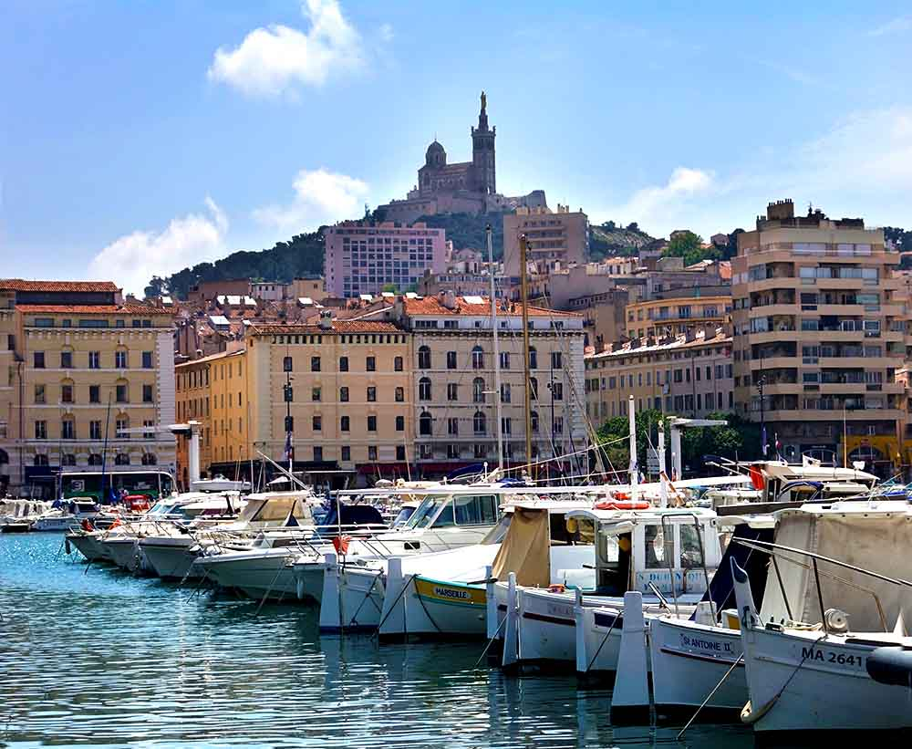 A view of Basilique Notre-Dame-de-la-Garde from the port in Marseille.