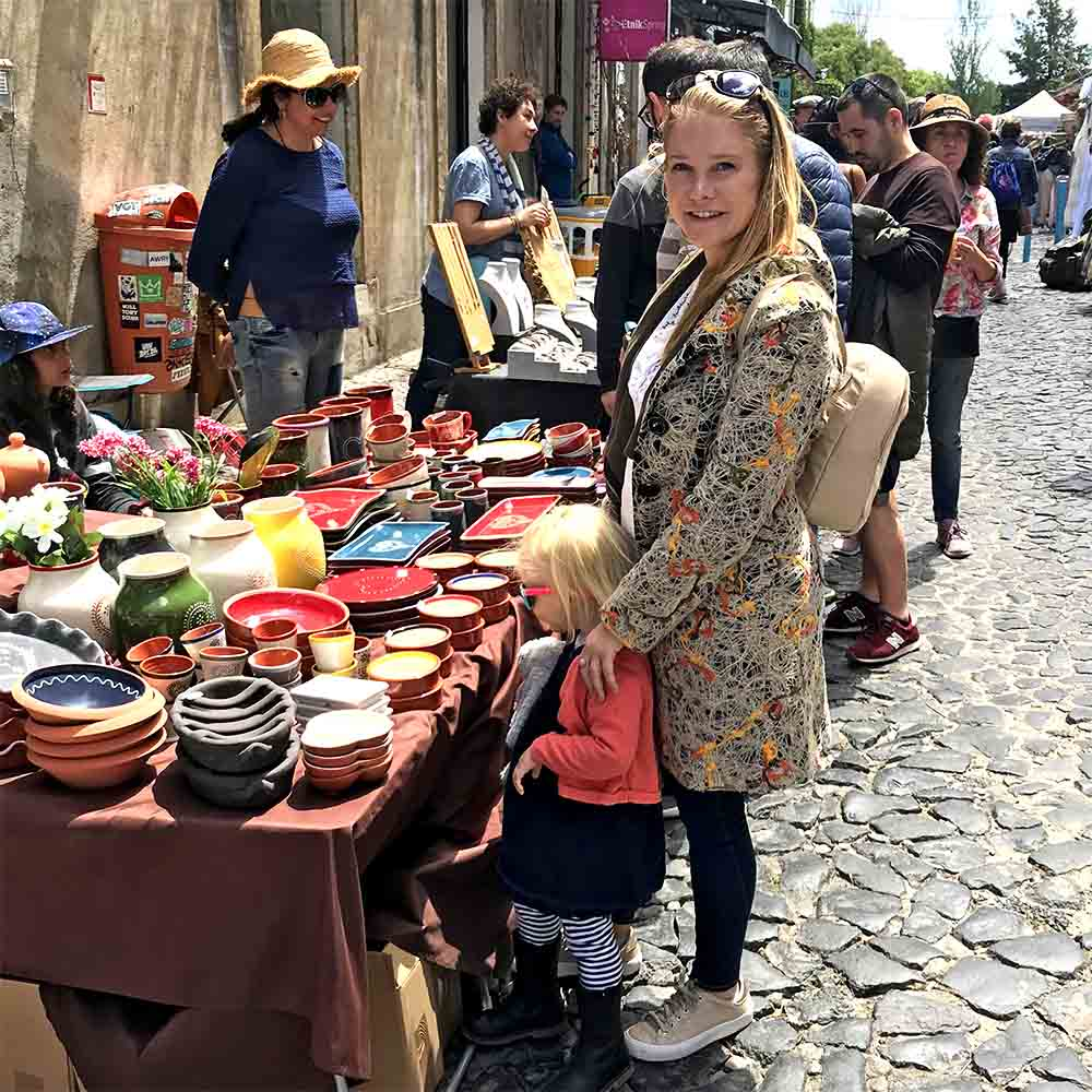 Shopping for ceramics at the LX Factory Sunday Market.