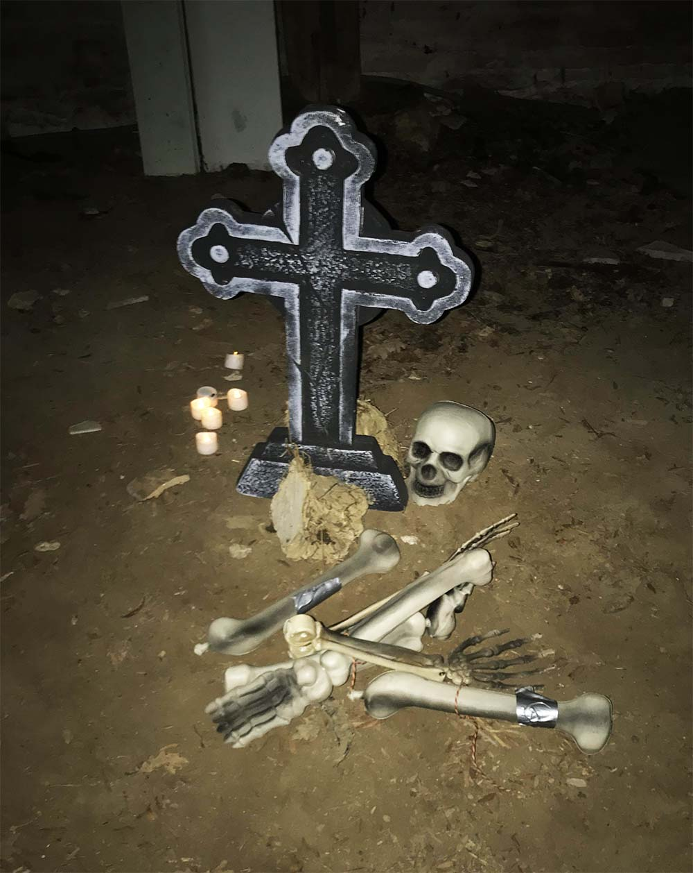 The grave, along with the missing bones the children collected throughout the hunt.