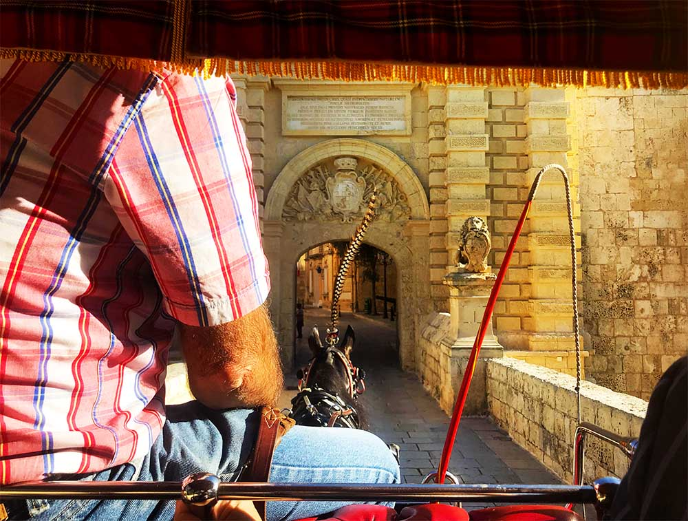 Riding into the entrance of the Mdina.