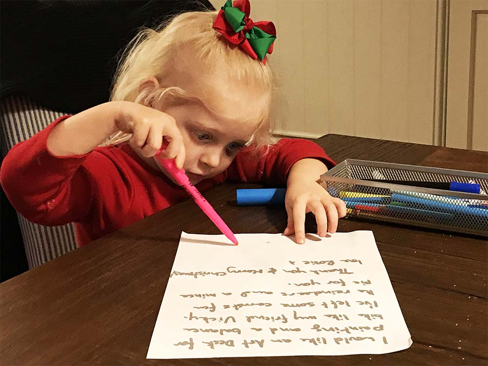 Rosie adding a few finishing touches to the letter.
