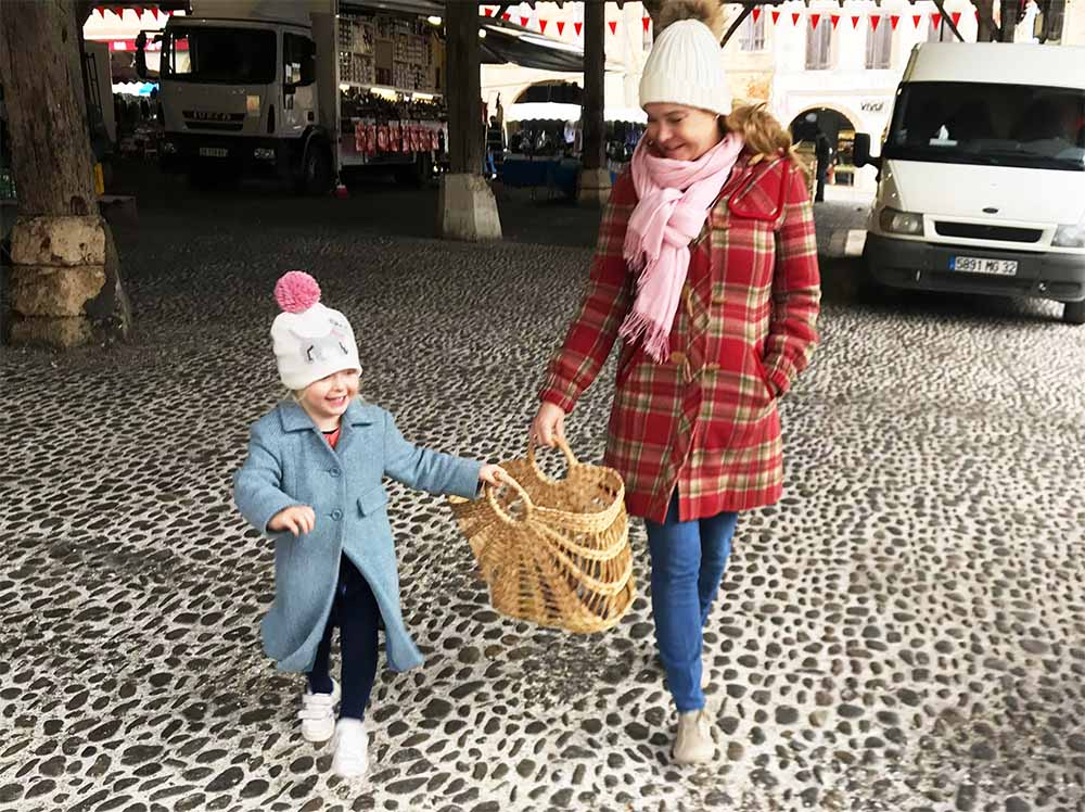 Rosie and I buying the last of our Christmas groceries at our local farmer's market on the Saturday before Christmas.