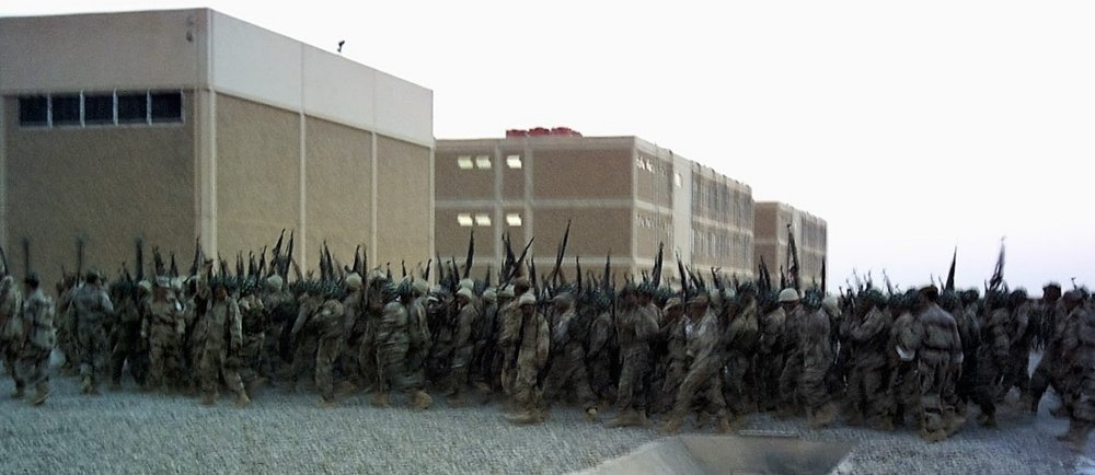 June 30, 2004: Fifth Battalion soldiers celebrate the end of their intensive training. Iraq regained its sovereignty just two days earlier. The real struggle was about to start.