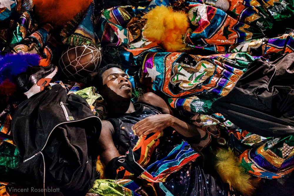 "Sleepy & exhausted young man, in the Center of Rio de Janeiro, after 5 days of Carnival as a ""bate-bola"" clown. Tuesdays of Carnival, the cityhall organize a competition for the most beautyfull clowns, in Cinelandia, Centre of Rio de Janeiro."
