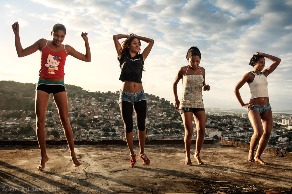 "Funk on the rooftops. Elaine, Cris, Aninha & Dani, of the ""Tchutchucas"" band, are rehearsing their new choreography on the rooftop of Elaine's house in the Vila Cruzeiro favela, Rio de Janeiro. Their spicy rap responds to the MCs'macho attitude."