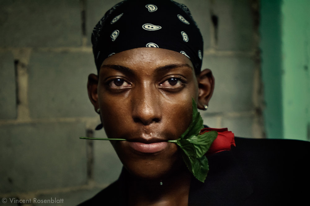 "Funk ball in Belford Roxo, near Rio de Janeiro. This funk dancer is using a rose, symbol of the boys band ""The Don Juans"", famous for their romantic raps.."