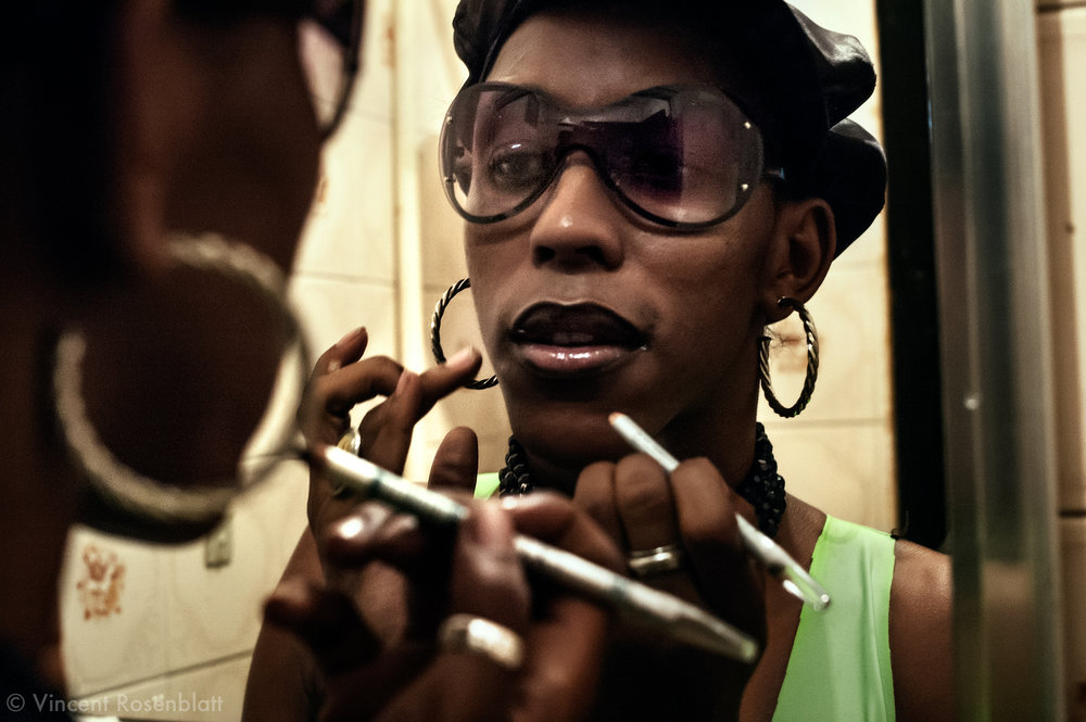 "Late Lacraia (""centipede""), dancer and transvestite, was famous for her duo work with MC Serginho, from the favela Jacarézinho : after years touring bailes Funk, they even used to present newcomer artists on TV. Lacraia was without doubt the most rapid and supple Funk dancer on the Carioca scene. Photo: Lacraia putting on her make up before entering the stage at club Nova Show in São Gonçalo. He died of TB in 2011."