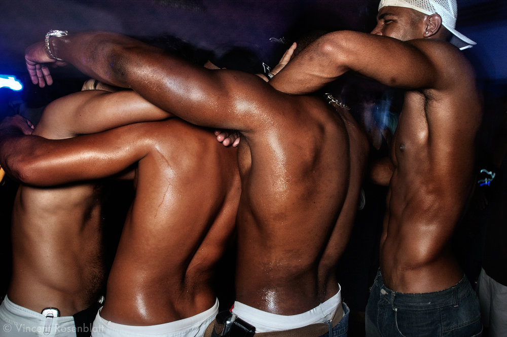 """""""Baile"""" at the club Boquerão, downtown, Rio de Janeiro 2006. In the heat of the """"baile"""", boys will often drop take off their T-shirt. But to draw attention, choreographic inventivity and body movements will make the difference!"""