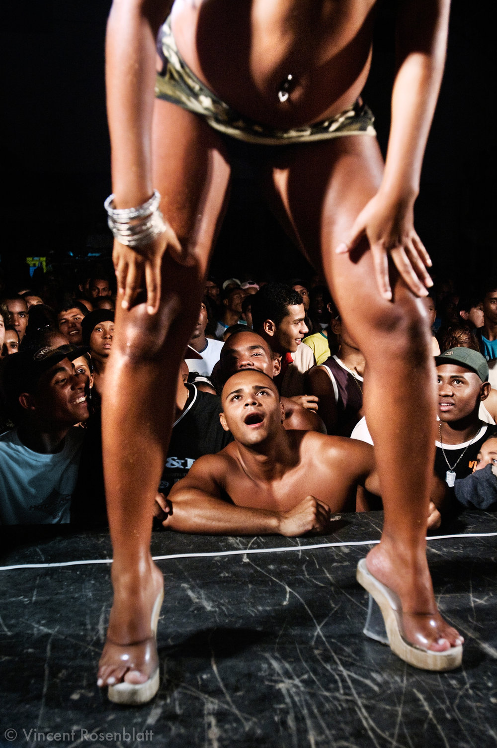 """Daiane, then a dancer of """"Bonde da Loura"""", known under the nickname """"Mulher Jaca"""" (Jaca : a tropical fruit) performing during a Baile funk in Nova Iguacu, in Rio de Janeiro's suburbs. Numerous MCs perform with female or male dancers who sometimes give a hint of a strip tease."""