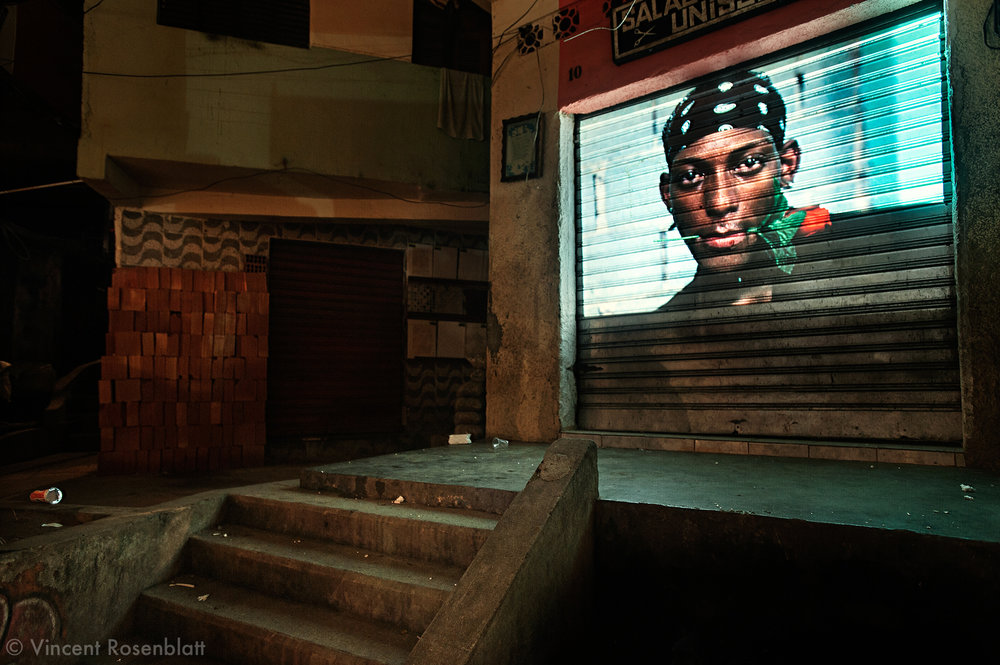 """Projection of the series """"Rio Baile Funk"""" during a Funk event,  in favela Santa Marta, South area of Rio de Janeiro. After years documenting and photographing the bailes funk , it seemed only fair to show this work where it actually took place.."""