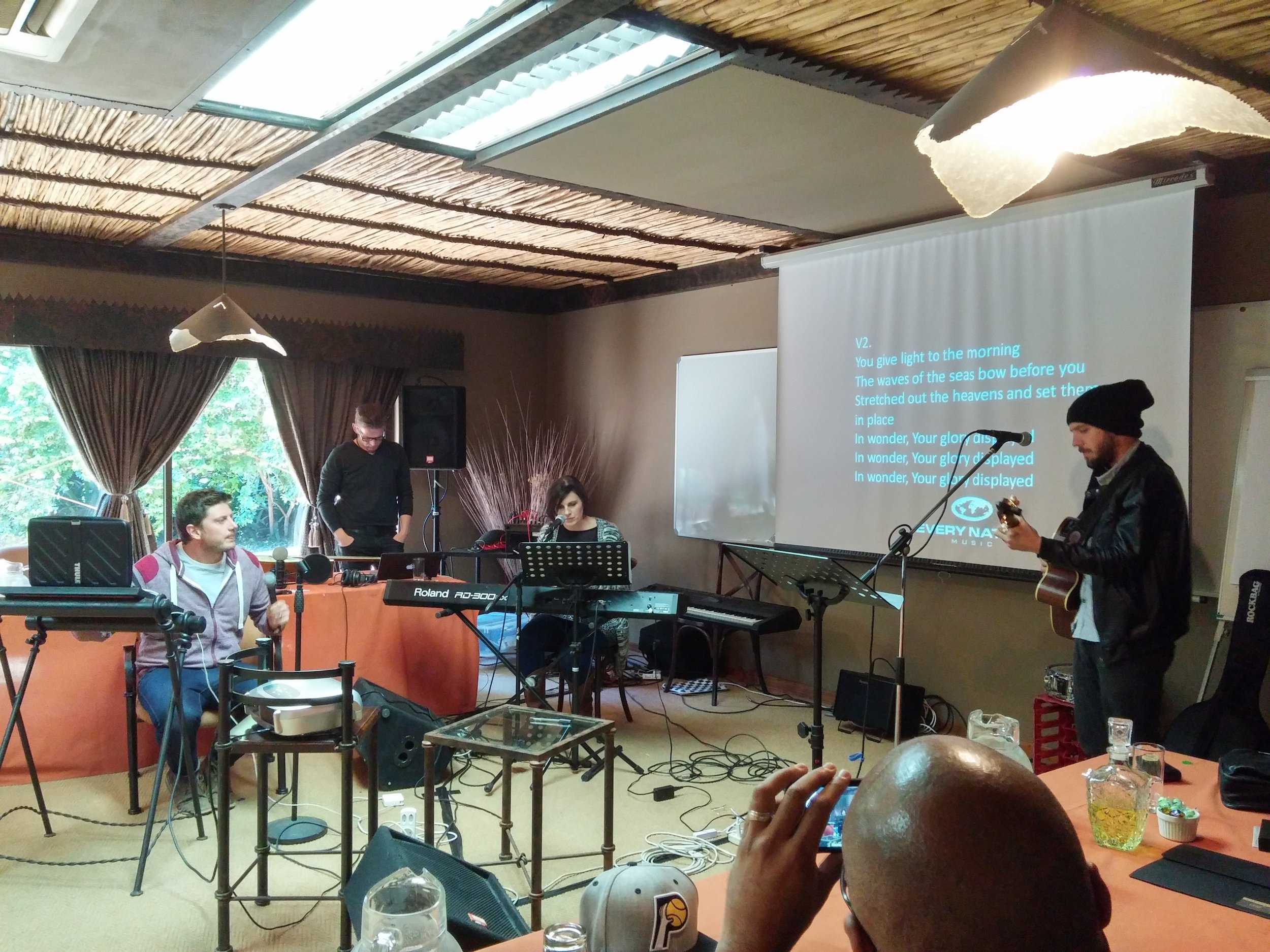 "Writers -present their song, ""We Stand In Awe"", -at the Worship Writers' Workshop in Pretoria, South Africa."