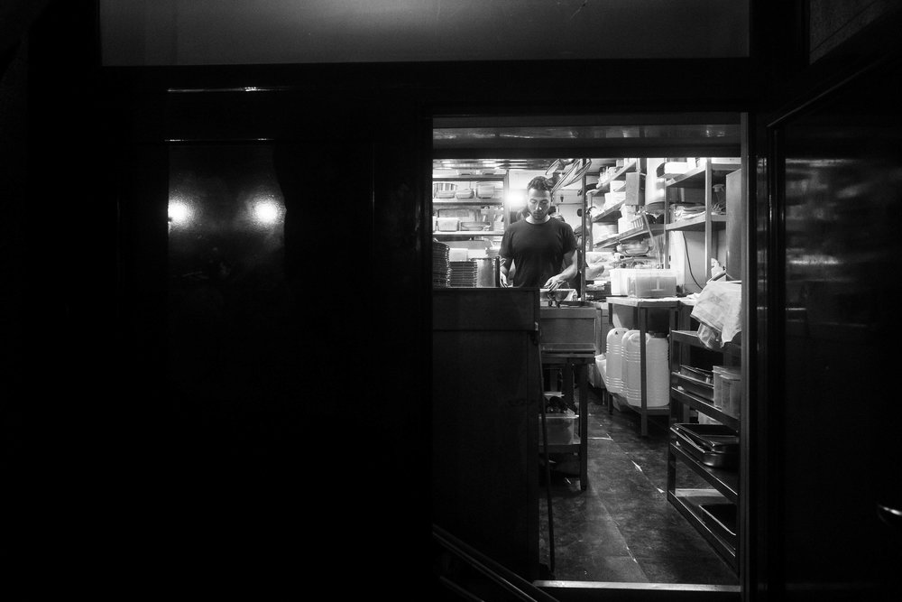 Restaurant worker in Huertas.