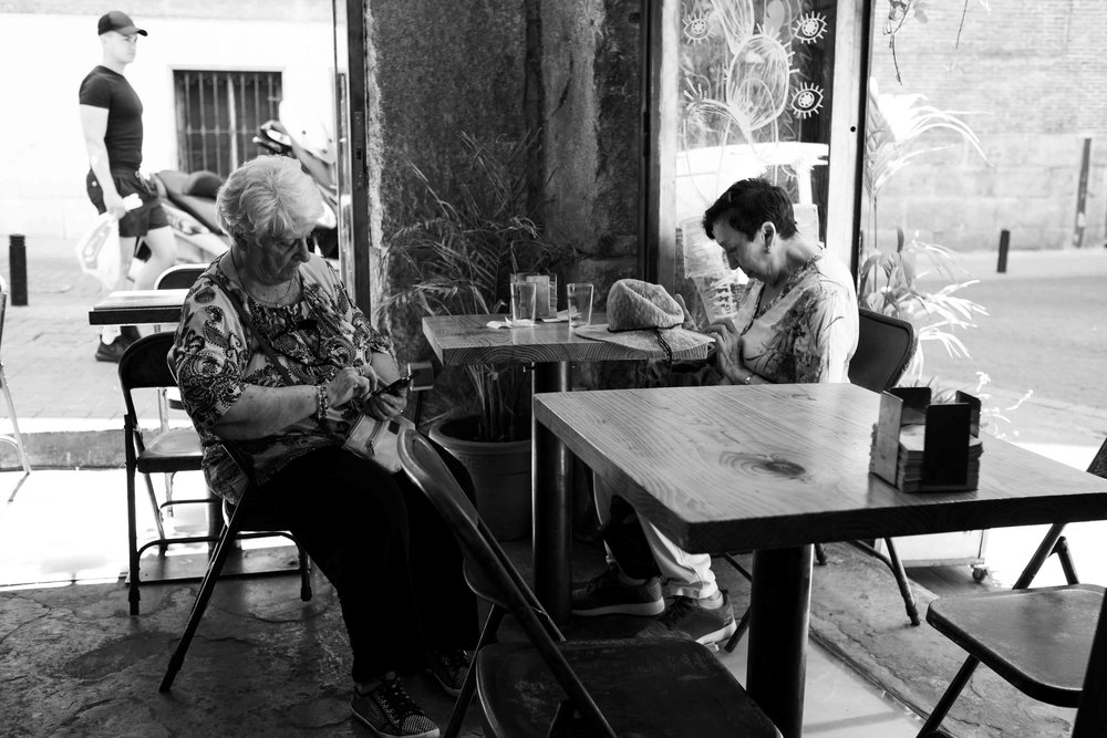 Conversation dries up in a Malasaña bar.