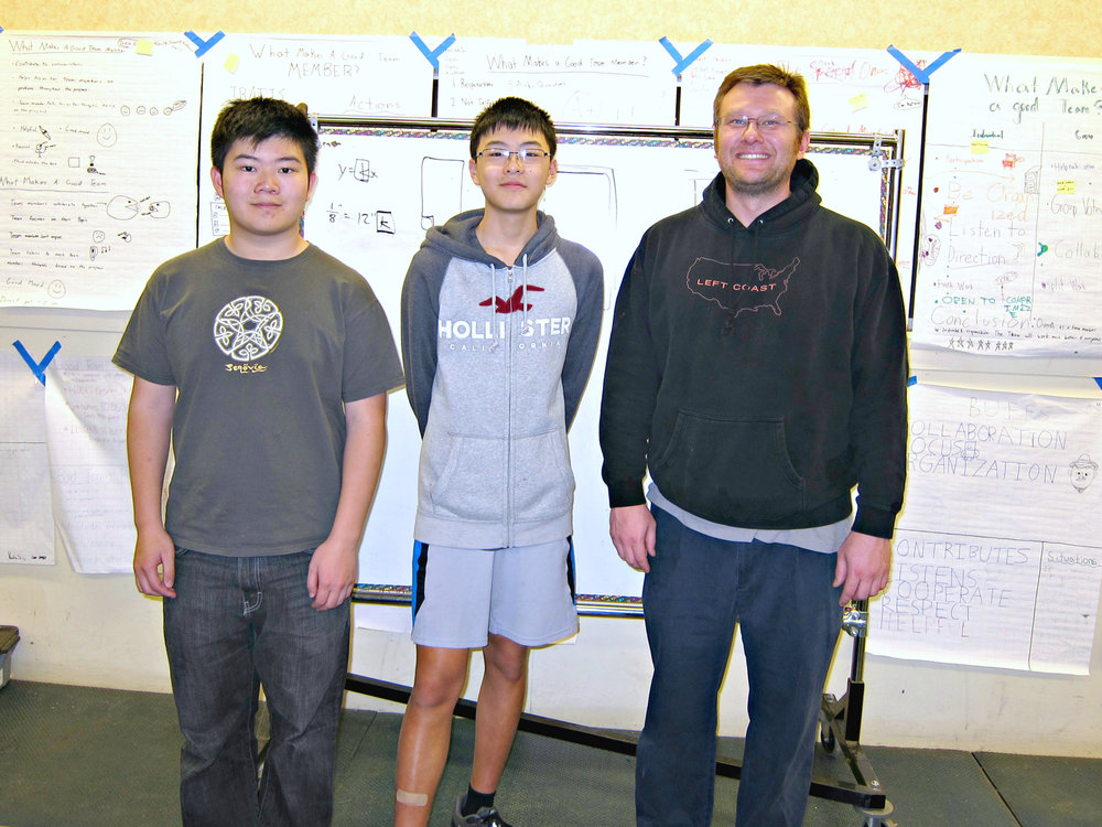 Computer-in-a-Box instructors: Terence Lee, Daniel Lim, Egan Teacher Peter Swenson (left to right)