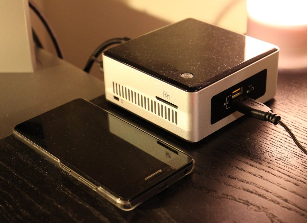 - Intel NUC beside a Lenovo A6000 for size comparison