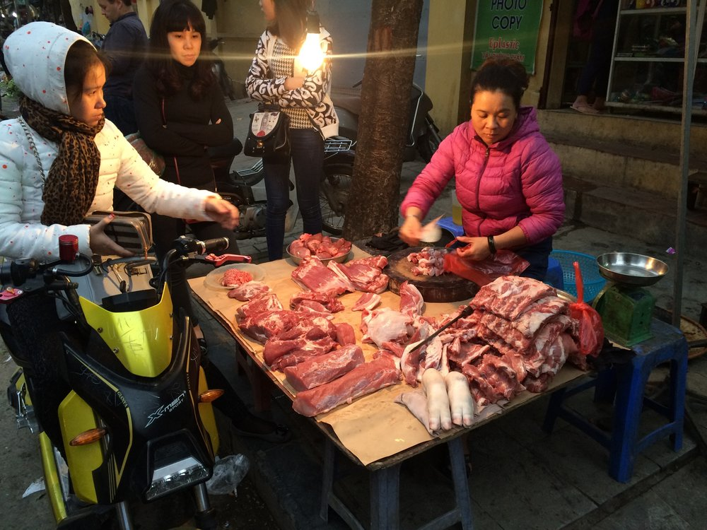 Meat sales in action in Hanoi's Old Quarter Market.
